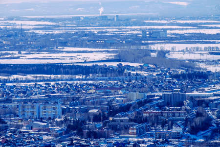 increased: Winter landscape, small houses increased in Siberia, Russia Stock Photo