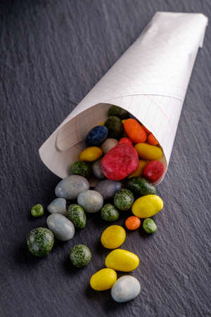 moderate: Delicious candy in bags on a beautiful slate blackboard. Stock Photo