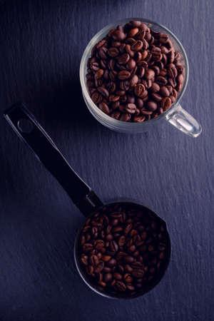 coffeetree: Delicious coffee beans on slate board. lit studio lights.