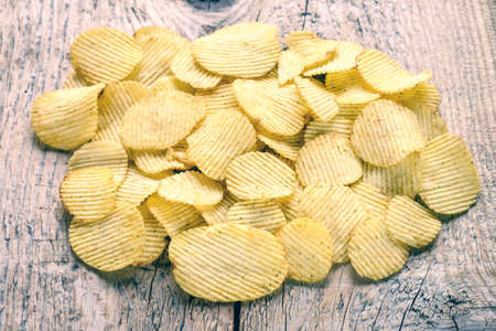 Delicious beautiful chips are removed with the light from the window. Stock Photo