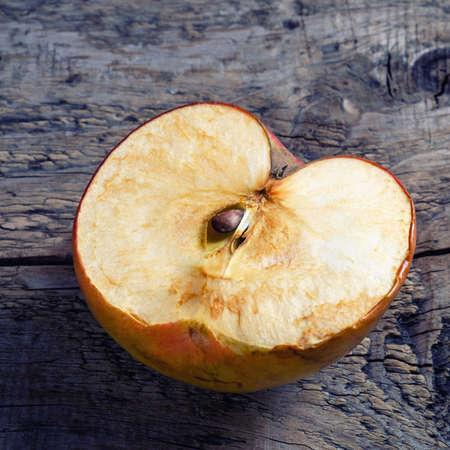 sliced apple: Sliced apple on the old wooden background.