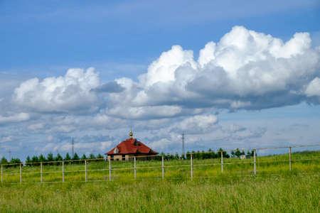 Church in a beautiful field. Siberia, Russia
