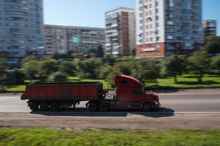 semitruck: truck driving on a road - slow shutter