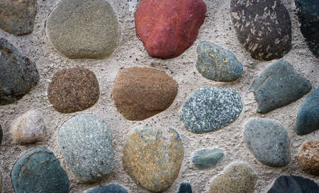smudge: The stones embedded in the concrete foundation and background Stock Photo