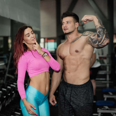 simulator: Girl and Men trainer engaged in simulator in gym