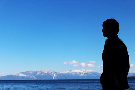man standing at blue sky silhouette