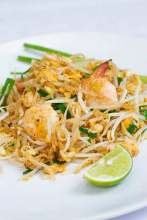 Pad Thai Thai food stir-fried rice noodles with shrimp and lime photo