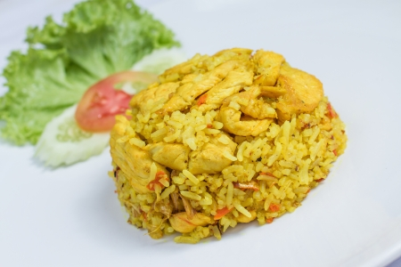 close up fried rice with yellow ginger with chicken, Thai food on white dish photo