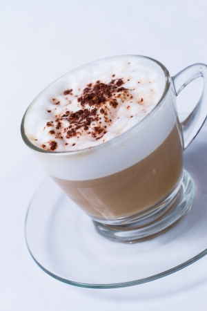 capacino: Cappuccino in a cup on white background
