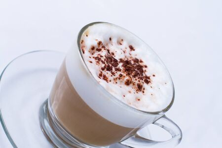 Cappuccino in a cup on white background photo