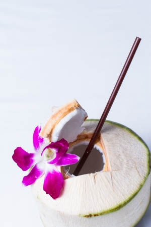 Fresh Coconut Water Drink on white background photo