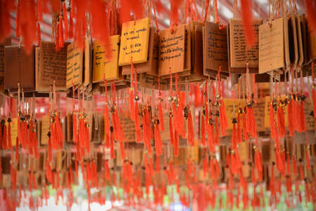 ema: SUPHANBURI, THAILAND - FEB 1, 2015: Ema at Suphanburis shrine of the city Pillar. Ema are small wooden,People write their wish on a wooden tablet Editorial