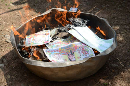 burning money: Burning Ghost money paper on Chinese New Year February 7, 2016