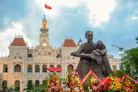 Statue of Ho Chi Minh and People's Committee Building in Ho Chi Minh City, Vietnam