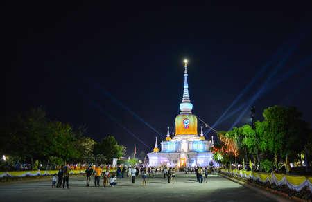 dun: Na Dun, Thailand - February 25, 2016 : People walk and pray around Phra That Na Dun Temple on Makha Bucha day