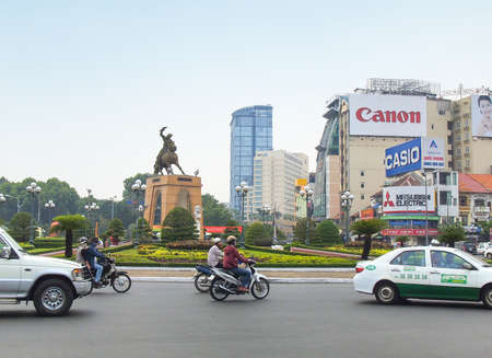 locate: Ho Chi Minh City, Vietnam - March 7, 2013 : Tran Nguyen Han statue locate at Quach Thi Trang traffic circle, before Ben Thanh market, the ancient statue existed 1975 at center of city, Viet Nam