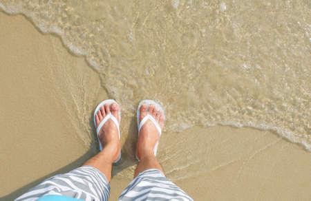 footware: White flipflop sandals on sea beach