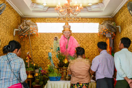 Yangon, Myanmar - April 25, 2016 : People praying to Nut Bo Bo Gyi traditionally refers to the name of a guardian spirit  unique to each Burmese Buddhist temple or pagoda.