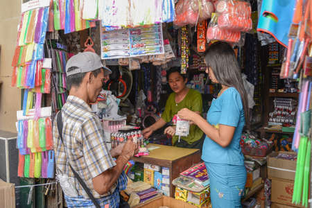 people buying: Yangon, Myanmar - April 25, 2016 : People buying goods in traditional burmese convenience store Editorial