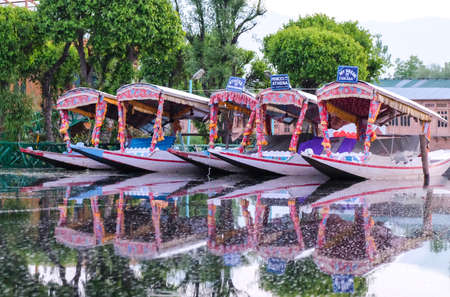 Srinagar, India - 25 April, 2017 : Shikara, a small boat,  People use for transportation in the Dal lake of Srinagar, Jammu and Kashmir state, India.