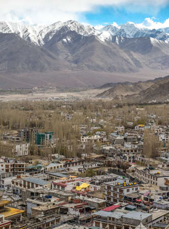 The city of Leh,  Leh city is located in the Indian Himalayas at an altitude of 3500 meters.  viewed from Leh Palace Editorial