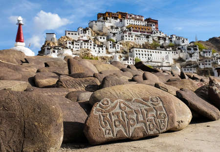 "Mani stones in front of  Thiksey Monastery , inscribed with the six syllabled mantra of Avalokiteshvara Om mani padme hum  means  ""Praise to the jewel in the lotus."" Stock Photo"