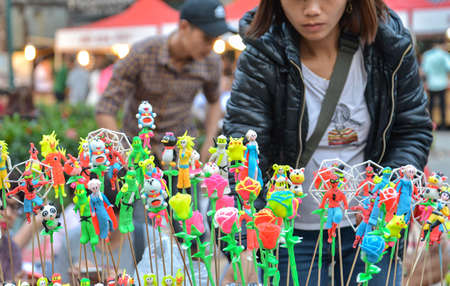 Hanoi, Vietnam - Feb 19, 2107 : Vietnamese traditional toys (called To He) for children from special material of grain and colorful flour for sale on Hanoi old quarter walking street at the weekend.