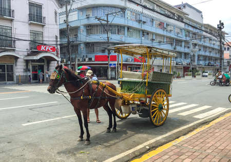 Manila, Philippines - JULY 19, 2015 : A Kalesa (or Horse Carriage) in Historic Town of Intramuros, Manila. Intramuros is a Spanish colonial town
