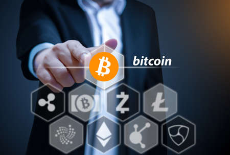 suite: Business man points his finger at Bitcoin icon, Concept of  Cryptocurrency, a digital currency