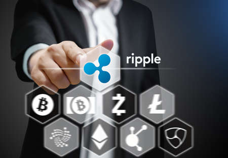 Business man points his finger at Ripple icon, Concept of  Cryptocurrency, a digital currency