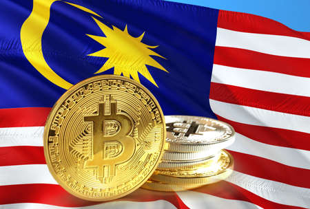 Bitcoin coins on Malaysias flag, Cryptocurrency concept photo