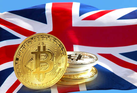 Bitcoin coins on UKs Union Flag, Cryptocurrency concept photo