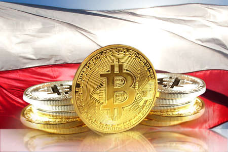 Bitcoin coins on Polands flag, Cryptocurrency concept photo