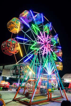 Roiet, Thailand - 20 Feb, 2018 ::  Ferris wheel  at Boon Koon Lan Temple fair in  Kasetwisai town, Roiet, Thailand