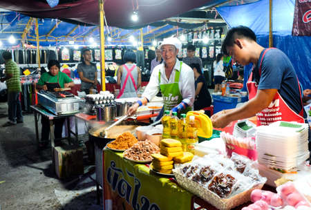 Roiet, Thailand - 20 Feb, 2018 :  An unidentified man cooking Pad Thai at Boon Koon Lan Temple fair in  Kasetwisai town, Roiet, Thailand. Street cooking is a tradition and ubiquitous in Thailand.