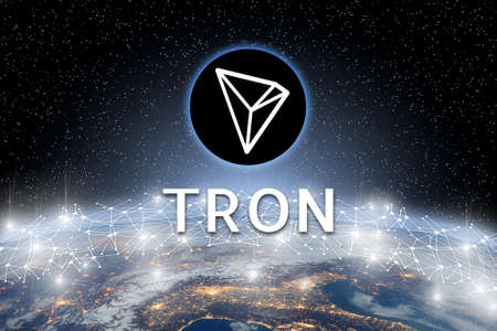 Concept of TRON coin floating over world network, a Cryptocurrency blockchain platform , Digital money Banco de Imagens