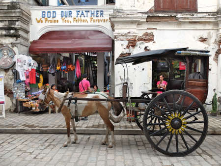 VIGAN, PHILIPPINES - JULY 25, 2015 : A Kalesa (or Horse Carriage) in Historic Town of Vigan. Vigan is a UNESCO World Heritage Site in that it is one of the few Spanish colonial town Editöryel