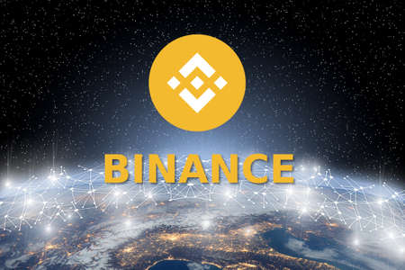 Concept of Binance coin Levitating over world network