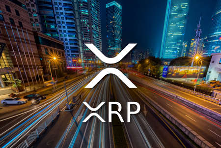 Concept of  XRP Ripple coin moving fast  on the road, a Cryptocurrency blockchain platform , Di Editorial