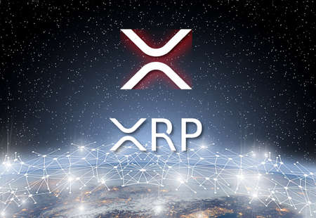 Concept of  XRP Ripple coin Levitating  over world network, a Cryptocurrency blockchain platform , Digital money