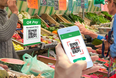QR code payment , cashless shopping , cashless online technology concept. Editorial