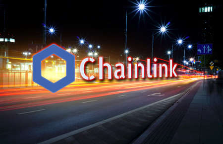 Concept of Chainlink coin moving fast on the road, a Cryptocurrency blockchain platform , Digital money Stock Photo