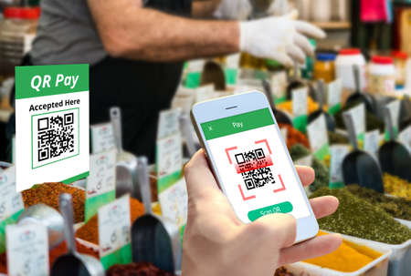 Smartphone scanning QR code payment, Smart Payment technology, shopping , cashless society concept. 写真素材
