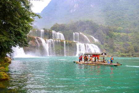 Cao bang, Vietnam - Nov 30, 2018 : Tourist visiting Ban Gioc Waterfall or Detian Falls by Bamboo boat