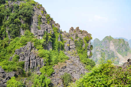 Hang Mua Mountain viewpoint or Mua Caves Ecolodge, Stunning view of Tam Coc area with mountain range, rice fields and waterway. 版權商用圖片