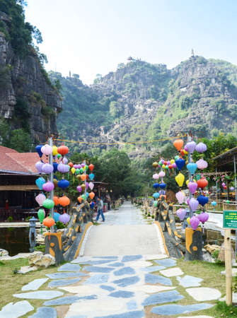 Ninh Binh, Vietnam - Nov 26, 2018 : Hang Mua Mountain viewpoint or Mua Caves Ecolodge, Stunning view of Tam Coc area with mountain range, rice fields and waterway.