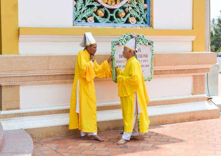 TAY NINH, VIETNAM - MARCH 8, 2013 : Monks, Cao Dai Temple Editöryel
