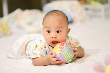 Cute little Asian baby playing Ball, Toy Stock fotó