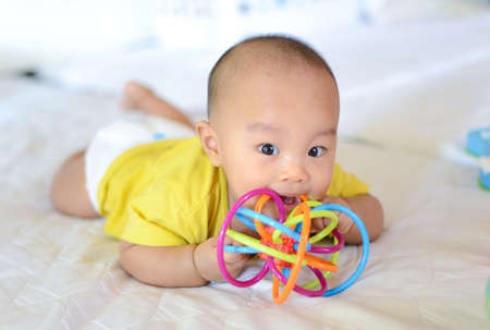 Cute little Asian baby boy chewing teething, Baby first toy Stock fotó