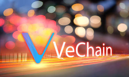 Concept of VeChain coin moving fast on the road, a Cryptocurrency blockchain platform, Digital money